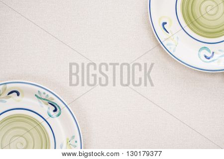 Colored plates on a light background in corners of image. Horizontal image.