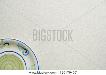 Coloured plate on a light background in corner of image. Horizontal image.