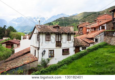 Old houses with tiled roofs in the town of Potes, Spain.