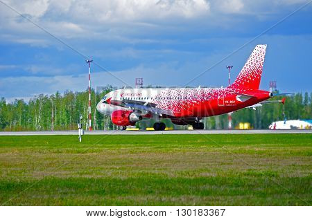 SAINT PETERSBURG RUSSIA - MAY 11 2016. Rossiya Airlines Airbus A319 airplane in new livery -registration number VQ-BCP. Airplane rides on the runway after arriving at Pulkovo International airport