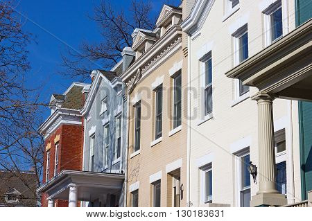 Residential row houses in US Capital on a spring morning. Colorful brick townhouses of Washington DC.