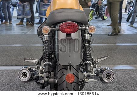 Rear view of new  motorcycle,  indoor photo.