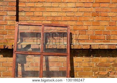 Glazed window frame on the brick wall background