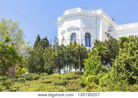 Background landscape view of  Livadia palace and park with cypresses