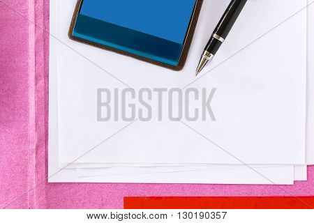 Pen and blank card and plain document paper on file folder with blank area or space background for writing