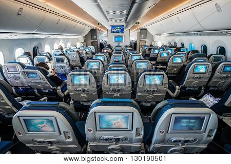WARSAW POLAND - FEBRUARY 25 2015. Passengers sits in Boeing 787 Dreamliner of LOT Polish Airlines before flying start in Warsaw