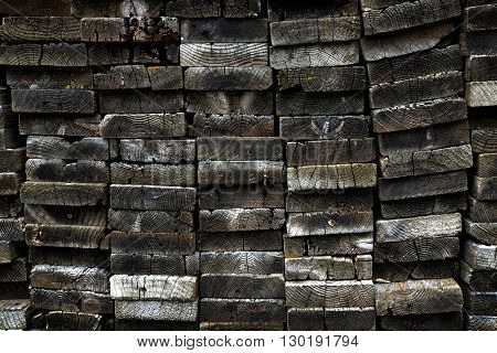 Old Wooden Boards Stacked in Heap Pile