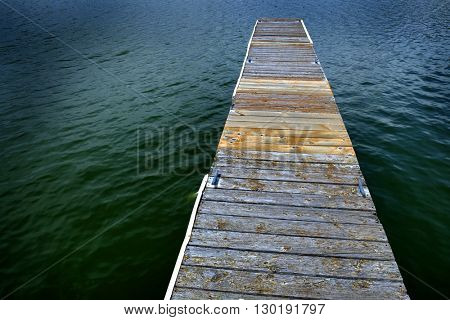 Old Wooden Dock with water shoreline
