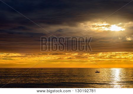 Boat with fishermen at sunset South Australia