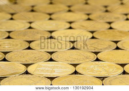 British money pound coins background laid flat with blur.