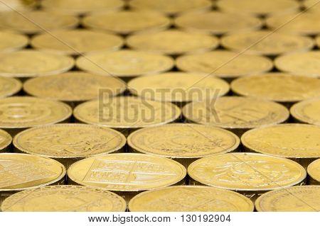 British money pound coins background laid flat with blur.