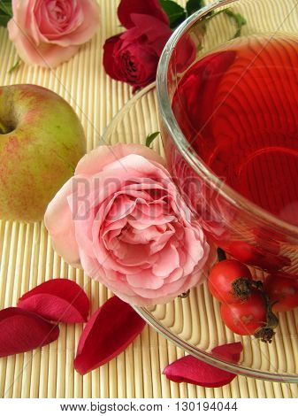 Fruits tea with rose hips, apples and rose flowers