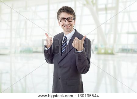 young business man going thumbs up, at the office