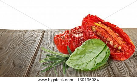 Sundried Tomatoes With Herbs On Wooden Table