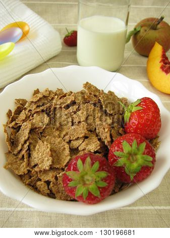 Breakfast for small children with spelt flakes and milk