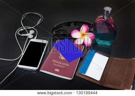 Blank Or Empy Credit Or Debit Card On Thailand Passport With Cellphone, Perfume, Sunglasses, Flower