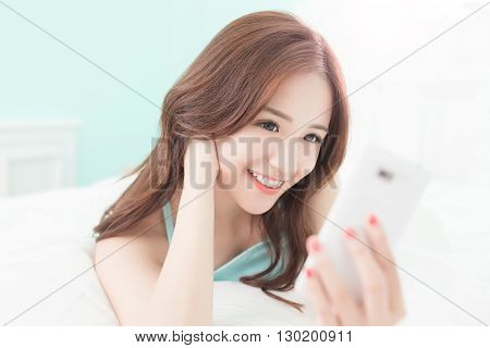 Health woman Smile take a selfie and she lying on the bed at home asian girl