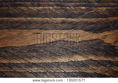 Dark stained textured wood.  Alternating dark and lighter wood pattern.  Graphic resource, abstract background or backdrop
