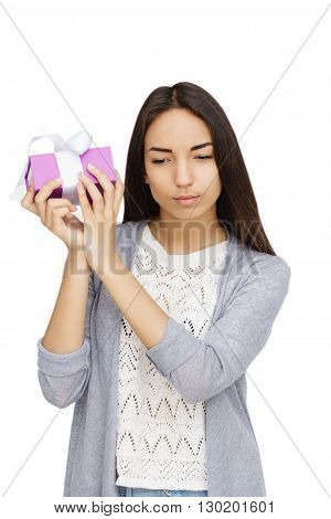 Young woman portrait checking gift on isolated background
