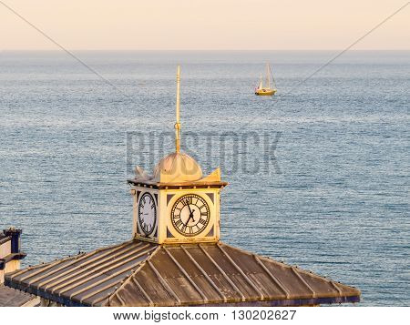 Old clock on a tower of Eastbourne's historical Victorian Pier