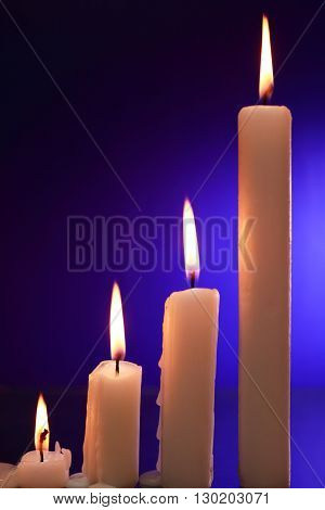Set of lighting candles on nice dark background