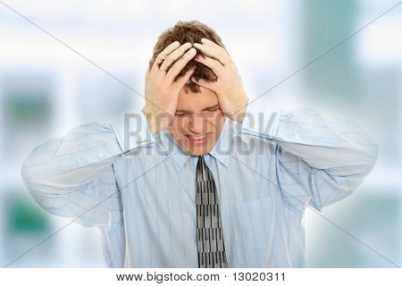 Businessman with a big headache (with copy space)