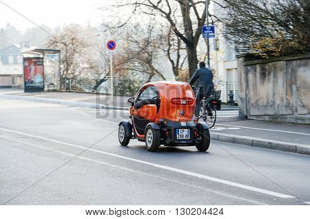 MULHOUSE FRANCE - DEC 19 2016: Renault Twizi electric car driving on the street of Mulhouse France