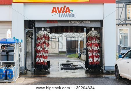 MULHOUSE FRANCE - DEC 19 2016: Automatic car wash in the center of the city of Mulhouse France - Avia Lavage auto - Avia car wash