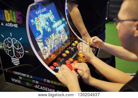 STRASBOURG FRANCE - MAY 8 2015: Man playing arcade game on od computer device