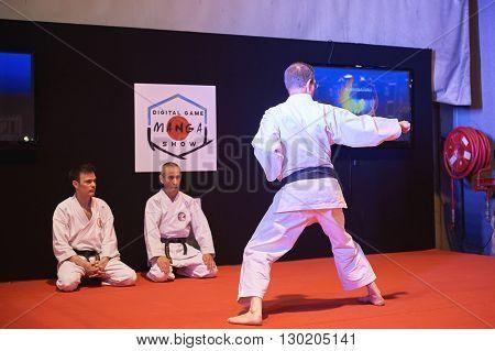 STRASBOURG FRANCE - MAY 8 2016: Man in karategi demonstration of his power