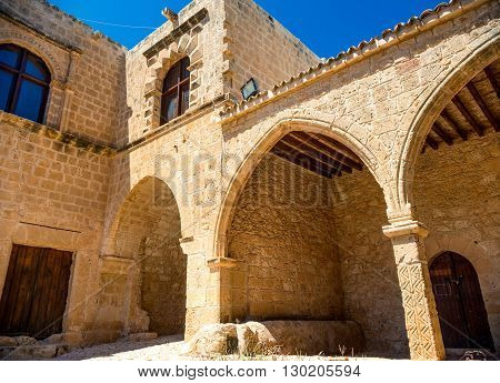 Ayia Napa monastery gates connected to the rampart surrounding monastery. Famagusta district. Cyprus.