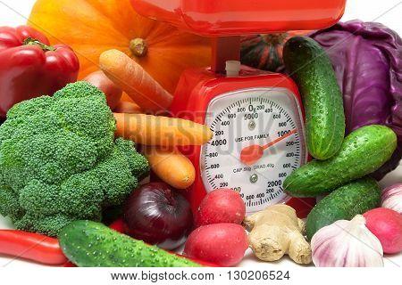 ripe fresh vegetables and kitchen scale closeup. horizontal photo.