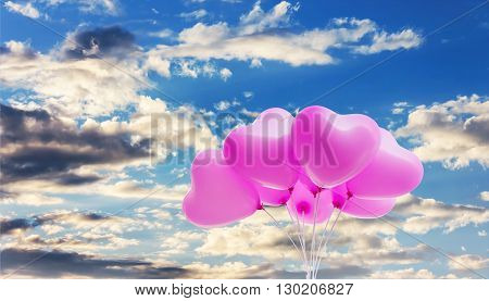 Group Of Lovely Pink Heart Pattern Balloons On Puffy Cloudy Blue Sky Background