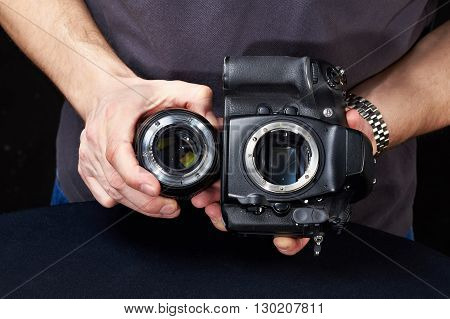 Photographer With Slr Camera Without Lens