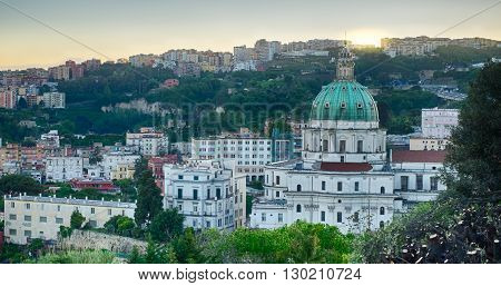 Sunrise on The Buon Consiglio church in Naples imitation of St. Peter in the Vatican. In backgroud the Vomero Hill