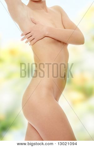 Close up photo of nude body of young fit female