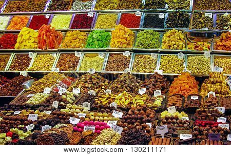 Sale of colorful cakes and sweets. Barcelona, Spain