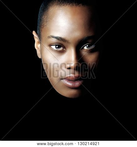 Beautiful Isolated Image of a Afro American Woman On Black