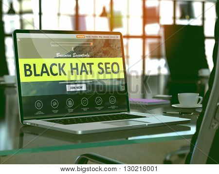 Modern Workplace with Laptop showing Landing Page with Black Hat Seo Concept. Toned Image with Selective Focus. 3D Render.