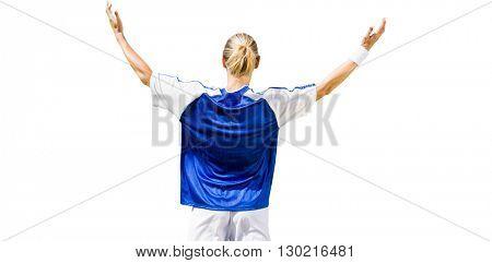 Rear view of sportswoman raising arms