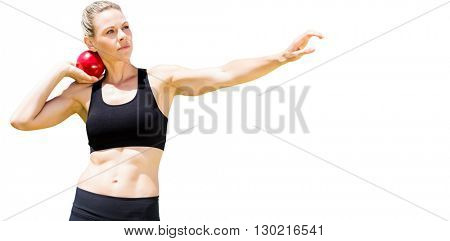 Front view of sportswoman practising shot put