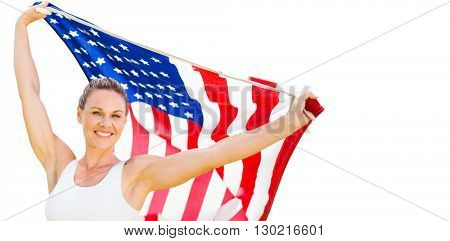 Portrait of happy sportswoman posing with an american flag