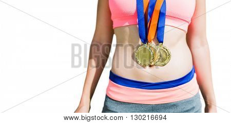 Close up of sportswoman chest with medals