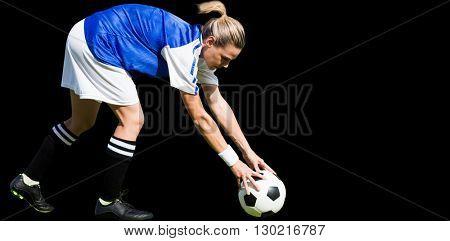 Portrait of sportswoman playing football