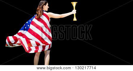 Rear view of american sportswoman holding a cup