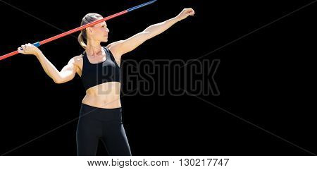 Front view of sportswoman practising javelin throw