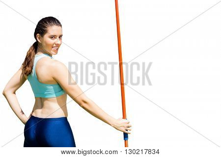 Rear view of sporty woman holding a javelin
