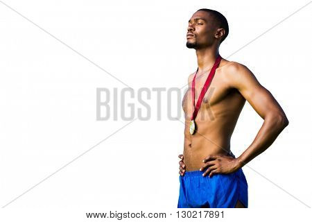 Athletic man posing with his gold medal