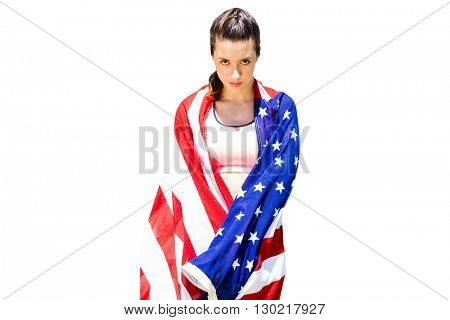 Portrait of sporty woman holding American flag