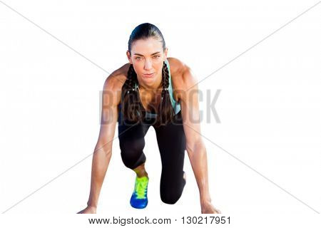 Sporty woman in the starting block